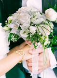 Wedding couple hands with bouquet Stock Photography
