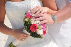 Wedding couple hands on flowers Royalty Free Stock Images