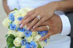 Wedding couple hands on flowers Royalty Free Stock Photos