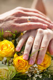 Wedding couple hands with golden rings Stock Photography