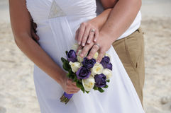 Wedding couple hands on purple flowers Royalty Free Stock Images