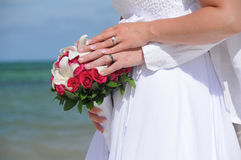 Wedding couple hands on red flowers Royalty Free Stock Images
