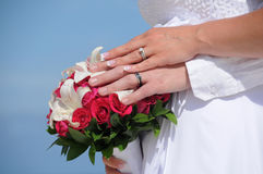 Wedding couple hands on red flowers Royalty Free Stock Photography