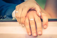 Wedding couple hands with their rings. Wedding couple take their hands together Royalty Free Stock Photo