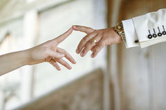 Wedding couple hands touching the index fingers Royalty Free Stock Images