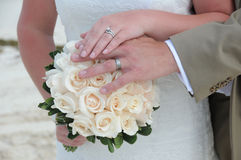 Wedding couple hands on white flowers Stock Image
