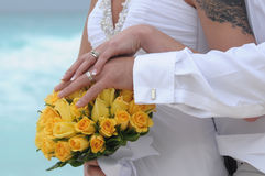 Wedding couple hands on yellow flowers Royalty Free Stock Photography