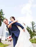 Wedding couple having fun and walk the streets of a city Royalty Free Stock Images