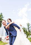 Wedding couple having fun and walk the streets of a city Royalty Free Stock Photography