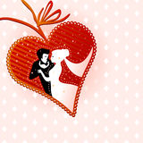 Wedding couple in heart-shaped frame. Wedding illustration of affectionate groom and bride in a heart-shaped frame Royalty Free Stock Photography