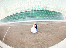 Wedding couple with high-tech architecture Stock Photography