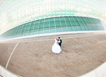 Wedding couple with high-tech architecture Royalty Free Stock Photo