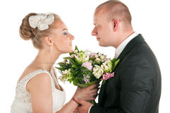Wedding couple are holding bridal bouquet Stock Image