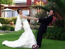 Wedding couple holding each other Stock Image