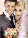 Wedding couple holding flower. Stock Photo