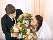 Wedding couple holding flower. Royalty Free Stock Images