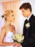 Wedding couple holding flower. Stock Images