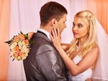 Wedding couple holding flower stock photo