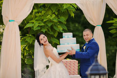 Wedding couple holding gifts. Happy Wedding couple holding gifts Stock Photos