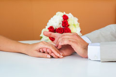 Wedding couple holding hands Royalty Free Stock Photos