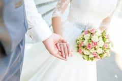 Wedding couple holding hands Stock Photos