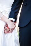 Wedding couple holding hands close up. Royalty Free Stock Photography