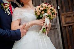 Wedding couple holding hands. Dark scene Stock Image
