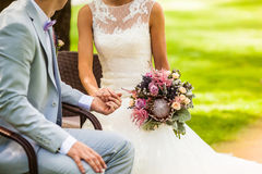 Wedding couple holding hands each other Stock Photo