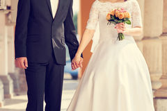 Wedding couple holding hands Stock Photos