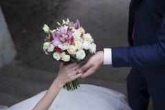 Wedding couple holding hands  Royalty Free Stock Photo