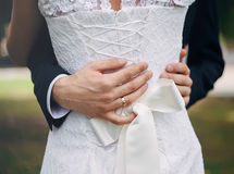 Wedding couple holding hands and hugging. Body part Stock Photo
