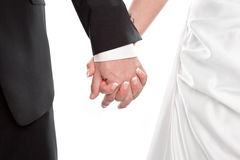 Wedding couple holding hands isolated on white. Stock Photos