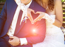 Wedding couple holding hands like a heart in sunny. Wedding couple holding hands like heart in sunny day Royalty Free Stock Photography