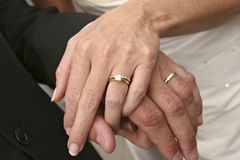 Wedding couple holding hands, showing rings Stock Images