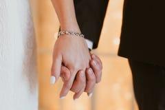Wedding couple holding hands Stock Image