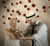 Wedding Couple Holding a Small travel Guide with Falling Rose Pe. Tals Royalty Free Stock Photos