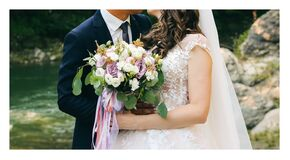 Free Wedding Couple Is Hugging Near The Mountain River. Groom And Bride With A Bouquet In Hands. Beautiful Flowers. Nature Waterfall Royalty Free Stock Images - 177738839