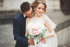 Free Wedding Couple Is Standing And Kissing In The Streets Of Old City Stock Photos - 72479483