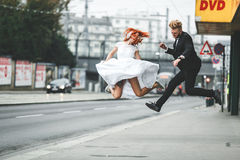 Wedding couple jumping in the city Royalty Free Stock Image