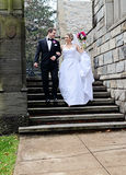 Wedding couple Just Married. A happy bride and groom walking out of church after their wedding Stock Photos