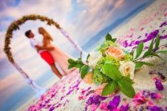 Wedding couple just married. Near the beach at Hawaii Stock Photos