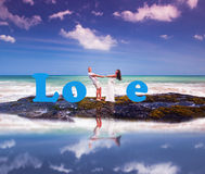 Wedding couple just married. Near the beach with love text Royalty Free Stock Images