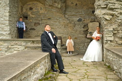 Wedding couple with kids. In romantic old ruins Royalty Free Stock Photos
