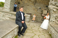 Wedding couple with kids. In romantic old ruins Stock Photography
