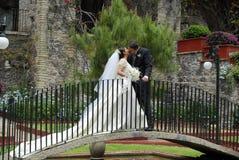 Wedding Couple kissing. Wedding couple  kissing in a bridge Royalty Free Stock Photography