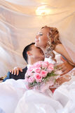 Wedding couple kissing Stock Images
