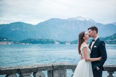 Wedding couple kissing on the background of a lake and mountains Royalty Free Stock Photo