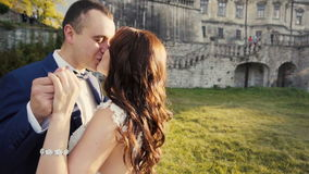 Wedding Couple Kissing Before Castle stock video