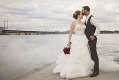 Bride and Groom standing in fog Stock Image