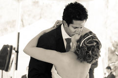 Wedding Couple kissing. And holding each other. Image in sepia tone Stock Images